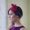 red vintage style fascinator with veiling