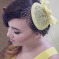 yellow fascinator with short veiling