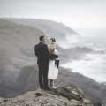 Bride and groom on Boho cliffs