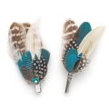 matching feather brooch and hair clip
