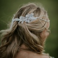 silver beaded hair chain side view with tassel at the back