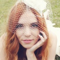 bird cage veil fascinator with ivory flower
