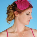 fuschia pink headpiece with veiling