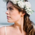 ivory flower crown with green leaves