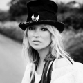 Kate moss wearing goth top hat in V-magazine