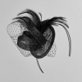 black wedding fascinator on a hair band by Holly Young