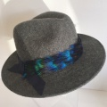 charcoal trilby with blue peacock feather trim