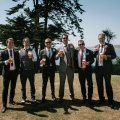 groomsmen with paper flower button holes
