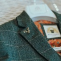 stag lapel pin on tweed suit
