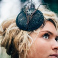 peacock fascinator shown in all black