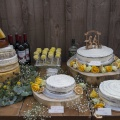 yellow theme wedding cakes table