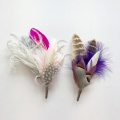His and hers feather corsages