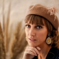 tan beret with feather hat pin holly young
