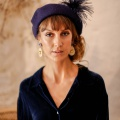 navy beret with feather hat pin
