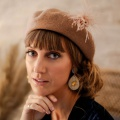 tan beret with pompom hat pin