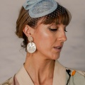 light blue bow fascinator with veil
