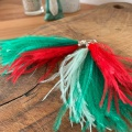 Green and red feather tassel earrings