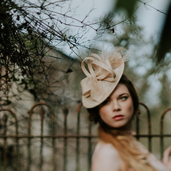 'Lydia' Nude disk shaped hat with peacock feather