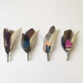 feather-buttonhole-pins-groomsmen.s