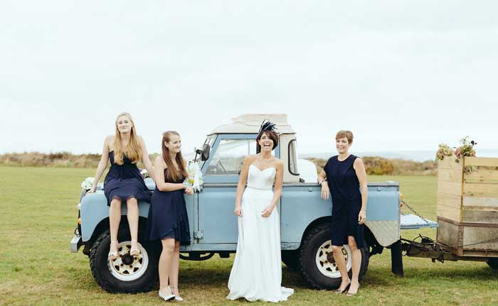 bride and bridesmaids by blue landrover